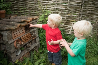 Children building a bug hotel © Katharine Davies