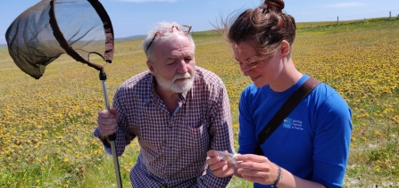 George and RSPB Uists Warden Heather Beaton with the great yellow bumblebee© Guthrie O'Brien
